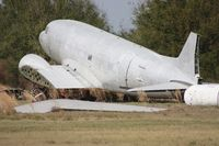 N130D @ F13 - Douglas C-47 missing wings after Hurricane Charley back in 2004