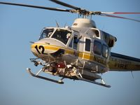 N120LA @ POC - LA Co crew waving to Pomona PD crew while on final for LA Co Air Ops helipad 2 - by Helicopterfriend
