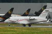 N604EM @ BFI - 2001 Bombardier CL-600-2B16, c/n: 5492