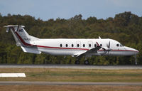VH-PSK @ YBBN - Queensland Police Service Beechcraft 1900 - by Thomas Ranner