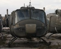 71-20026 @ MLB - UH-1H in storage - by Florida Metal