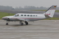 D-IAAC @ EGSH - Sat on stand at SaxonAir in very wet conditions. - by Matt Varley