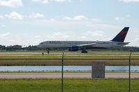N6716C @ RSW - 757 taking off RWY 6 destination DTW - by Mauricio Morro