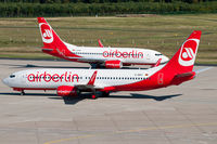 D-ABKY @ EDDK - Air Berlin D-ABKY with 'operated by TUIfly' sticker meets TUIfly D-AHXF wetleased to Air Berlin at CGN - by Thomas M. Spitzner