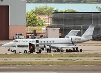N77OSC @ AUA - Loading of passengers on the platform of Reina Beatrix Airport - by Willem Göebel