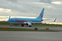 G-FDZO @ EGCC - G-FDZO Thomson Boeing 737-8K5 taxiing Manchester Airport. - by David Burrell