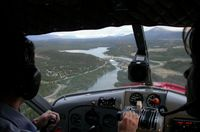 CF-FHZ @ CEZ5 - On approach to Lake Schwatka at Whitehorse, Yukon after a flightseeing tour. Shot at 10:18pm on June 21st, the longest day of the year. - by Murray Lundberg
