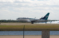 C-GWCN @ RSW - Touching down from Toronto - by Mauricio Morro