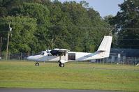 N469TS @ KOMH - Takeoff Orange - by Ronald Barker