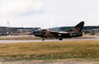 5527 @ EGQS - Portuguese Air Force A-7P Corsair II of 304 Esquadron lining up on Runway 05 at RAF Lossiemouth in September 1993. - by Peter Nicholson