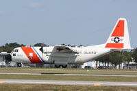 1502 @ KSRQ - USCG Clearwater 1502 performs training flight manuevers at Sarasota-Bradenton International Airport - by Jim Donten