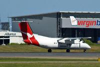VH-SDA @ YBBN - DHC-8Q-202 Dash 8 [482] (QANTASlink) Brisbane-International~VH 18/03/2007. Heat haze is a problem with here.