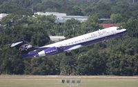 N946AT @ TPA - Air Tran 717 Baltimore Ravens