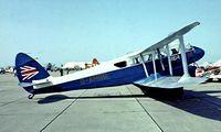 G-AHGD @ EG18 - De Havilland DH.89A Dragon Rapide [6862] RAF Bassingbourn 28/05/1978. Image taken from a slide. - by Ray Barber