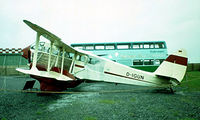 D-IGUN @ EDDL - De Havilland DH.89A Dragon Rapide [6437] (Air Classic) Dusseldorf~D 22/05/1982. Removed from roof of terminal and re-sited on road leading to the terminal along with other Air Classic aircraft. Image taken from a slide.