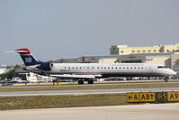 N914FJ @ KSRQ - US Air Flight 2675 operated by Mesa (N914FJ) arrives at Sarasota-Bradenton International Airport following a flight from Charlotte-Douglas International Airport - by Jim Donten
