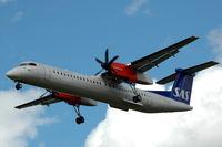 LN-RDL @ ESSA - SAS Dash-8-400 approaching Stockholm Arlanda airport, Sweden. - by Henk van Capelle