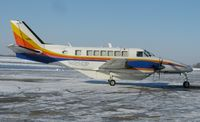 N125DP @ KAXN - A brightly colored Beech 99 from Bemidji Aviation taxiing out for departure.