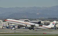 B-6050 @ KLAX - Departing LAX on 25R
