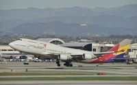 HL7418 @ KLAX - Departing LAX - by Todd Royer