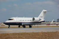 LV-BHP @ KFLL - Challenger 604 from Argentina taxying for take-off from FLL. - by FerryPNL