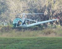 N103JA - 1956 HILLER UH-12C FLYING IN A FIELD AT UNITED HILICOPTER - by dennisheal