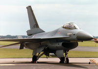 J-876 @ MHZ - F-16A Falcon, callsign Orange, of 323 Squadron Royal Netherlands Air Force on the flight-line at the 1997 RAF Mildenhall Air Fete. - by Peter Nicholson