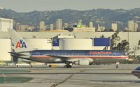 N338AA @ KLAX - Taxiing to gate - by Todd Royer