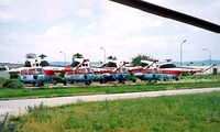 OM-EIP @ LZIB - Mil Mi-2 Hoplite [513830114] (Slov-Air) Bratislava-M R Stefanik~OM 21/06/1996. This the 2nd from the left along with 7 others shown stored here.