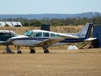 VH-ISM @ YMEL - This Beech Sierra is seen through the heat haze, parked at Melton airfield.