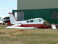 VH-MMN @ YBSS - Twin Comanche VH-MMN sitting beside the maintenance hangar at Bacchus Marsh, awaiting re-assembly perhaps,