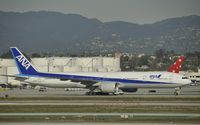 JA732A @ KLAX - Taxiing for departure - by Todd Royer