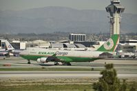 B-16483 @ KLAX - Taxiing to parking - by Todd Royer