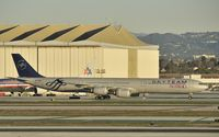 B-6053 @ KLAX - Taxiing to gate - by Todd Royer