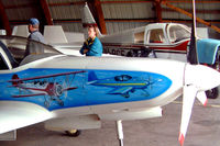 OH-XJP @ EFPI - Lancair 320 [169] Piikajarvi~OH 15/05/2003. Showing the art work on this side of the aircraft.
