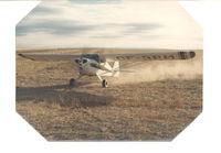 CF-RPM - CF-RPM taking off on prairie near Medicine Hat, Alberta. - by Unknown