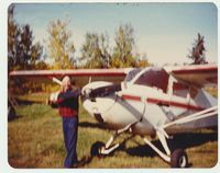 CF-OML - A fuzzy pic of Walt Pudar with his plane on his own farm airstrip in Sangudo Alberta. I took this picture in 1983. - by Mark Thompson