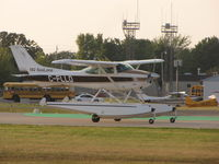 C-FLLO @ KOSH - Cessna 182 Sealane landing at Oshkosh - by steveowen