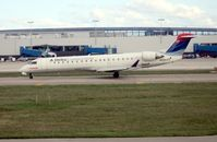 N669CA @ DTW - Comair CRJ-700 from window of Delta 757 on take off run