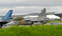 9243 @ EGQL - 211tl Gripen on the flightline at Leuchars airshow 2011 - by Mike stanners