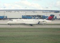 N8800G @ DTW - Pinnacle CRJ-200 waiting to depart taken from window of Delta 757