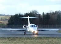CS-DMB @ EGPH - Netjets Hawker 400XP on taxiway bravo 1 - by Mike stanners