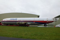 9M-MMI @ EGBP - ex Malaysia Airlines B737 fuselage on a lowloader at Kemble - by Chris Hall