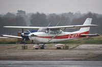 G-ATKT @ EGHH - Parked at Airtime North - by John Coates