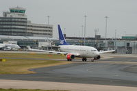 LN-RRR @ EGCC - SAS Boeing 737-683 taxiing at Manchester Airport - by David Burrell