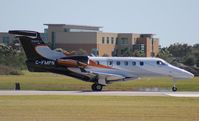 C-FMPN @ ORL - Phenom 300 in for NBAA - by Florida Metal
