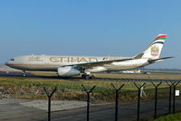 A6-EYI @ EGCC - Etihad Airways - by Chris Hall