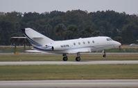 N18HN @ ORL - Falcon 20 at NBAA