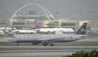 N170US @ KLAX - Taxiing to gate on a foggy morning - by Todd Royer