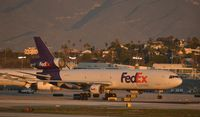 N522FE @ KLAX - Taxiing to parking at LAX